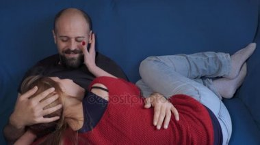 couple in love relaxed on the couch cuddling