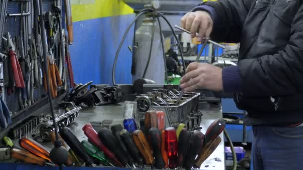 Hands of mechanic uses allen key on his work table stock video focus greentooth Image collections