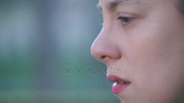 pensive sad woman'profile outdoor