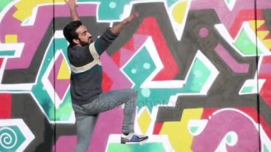 Portrait of young bearded man dance in the street- slow motion