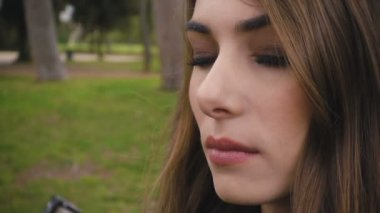 Beautiful young woman opens her blue eyes- slow motion
