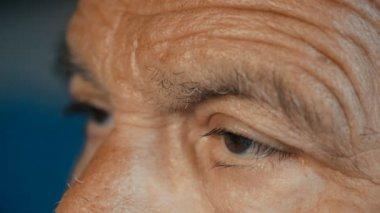 Close up on sad and depressed  old man's eyes