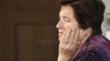 Profile of   thoughtful old woman in her thoughts