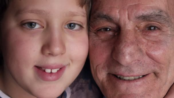 Close Up on smiling  faces Of Grandfather And Grandson