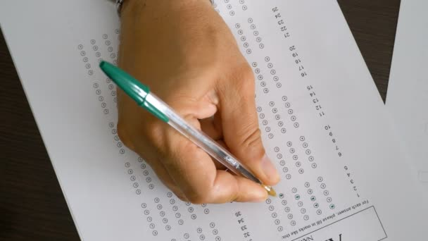 Students hand compiles test