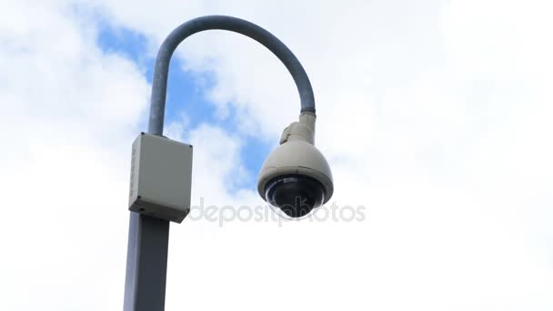 Surveillance camera on a street lamp