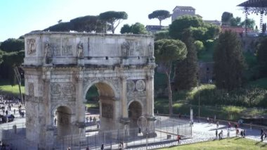 Wonderful view of Arch of Constantine with tourists- Rome, Italy