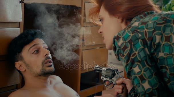 Drug addict woman threatens her boyfriend with a gun