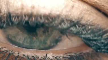Blue eye of woman closed opening