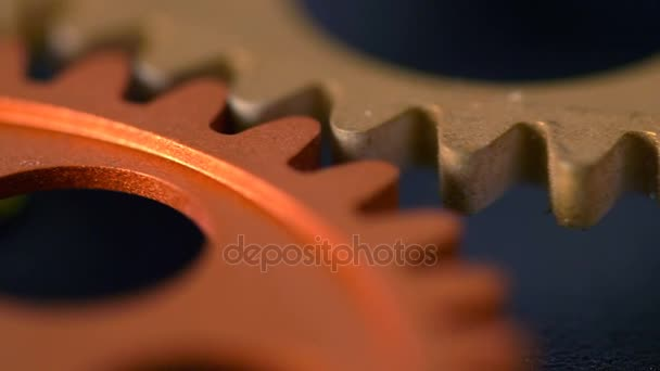 mechanism wheels spinning together, close up