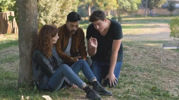 friendship, support, comfort: friends comfort sad friend at the park
