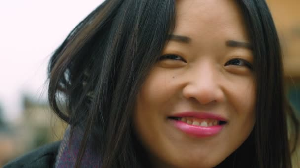 Young Asian woman happily smile, close up