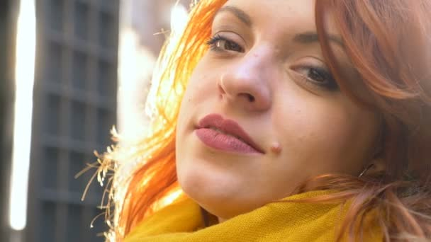 daydreaming relaxed pretty red hair woman-outdoor