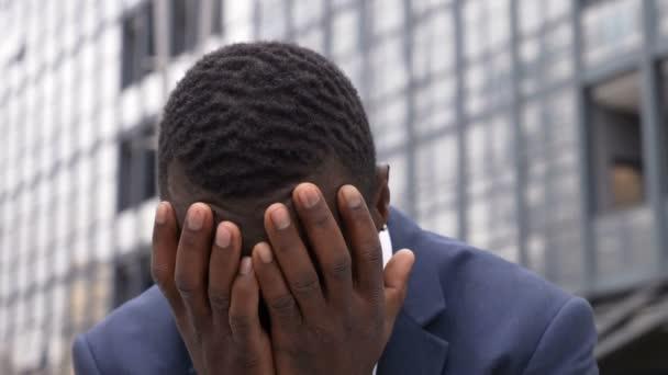 bankruptcy, dismissal- sad and desperate black businessman outdoor