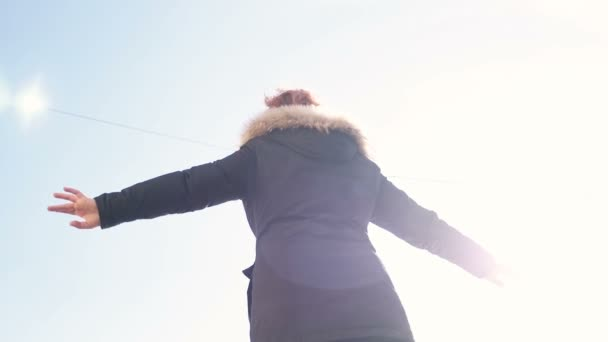 balance in  life concept-woman walks on beam in balance in sunny day-slow motion