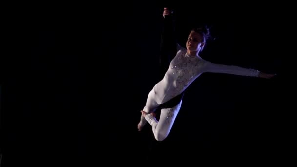 Girl dancer on aerial silk. Slow Motion. Aerial gymnastic. Acrobatic show.