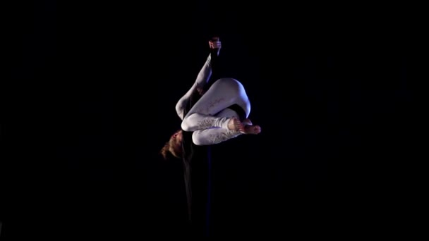 woman dancer on aerial silk, aerial contortion, aerial ribbons. Slow Motion