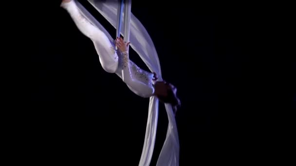 Girl dancer on aerial silk. Slow Motion. Aerial gymnastic. Acrobatic show.