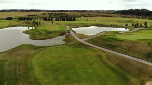 drone flies over a golf course