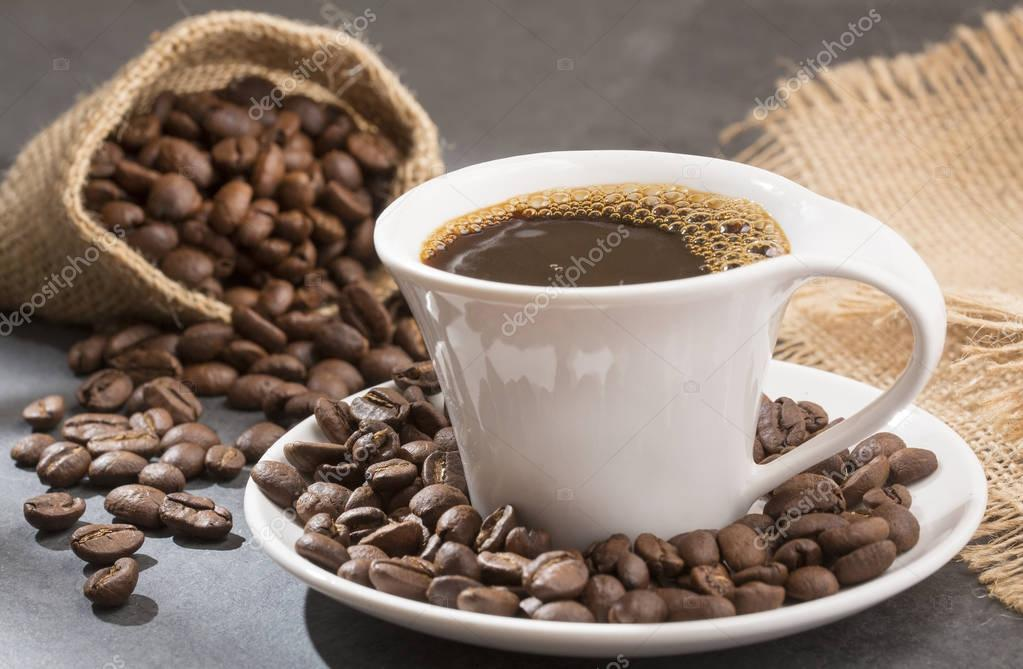 Coffee cup with coffee beans - Coffea