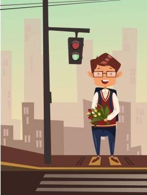 Boy standing at traffic light