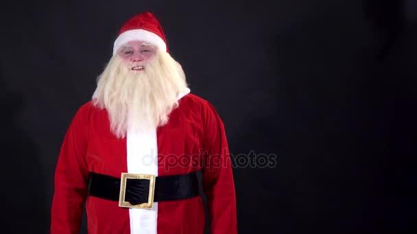 Santa Claus kíván kellemes karácsonyi ünnepeket, a fekete háttér