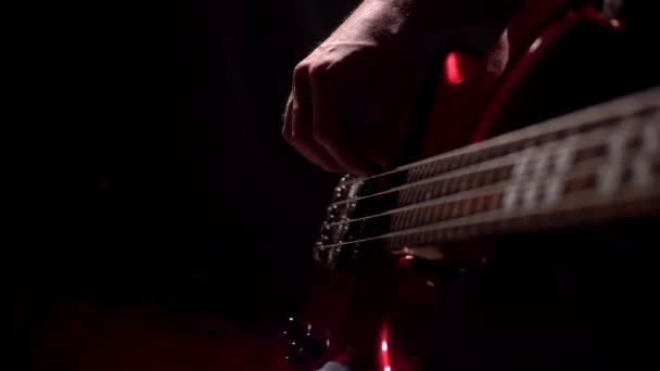 Musician playing five string electric bass guitar macro