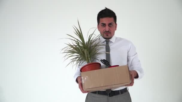 An office worker holds a box of things and breathes viciously