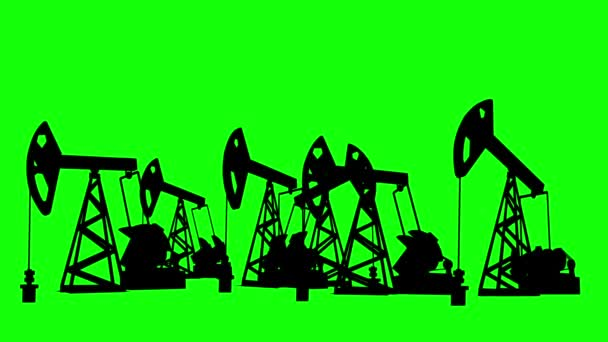 Equipment for oil production runs on chromakey. Silhouettes of oil pumping machines on a green background. Machines, black, for oil production