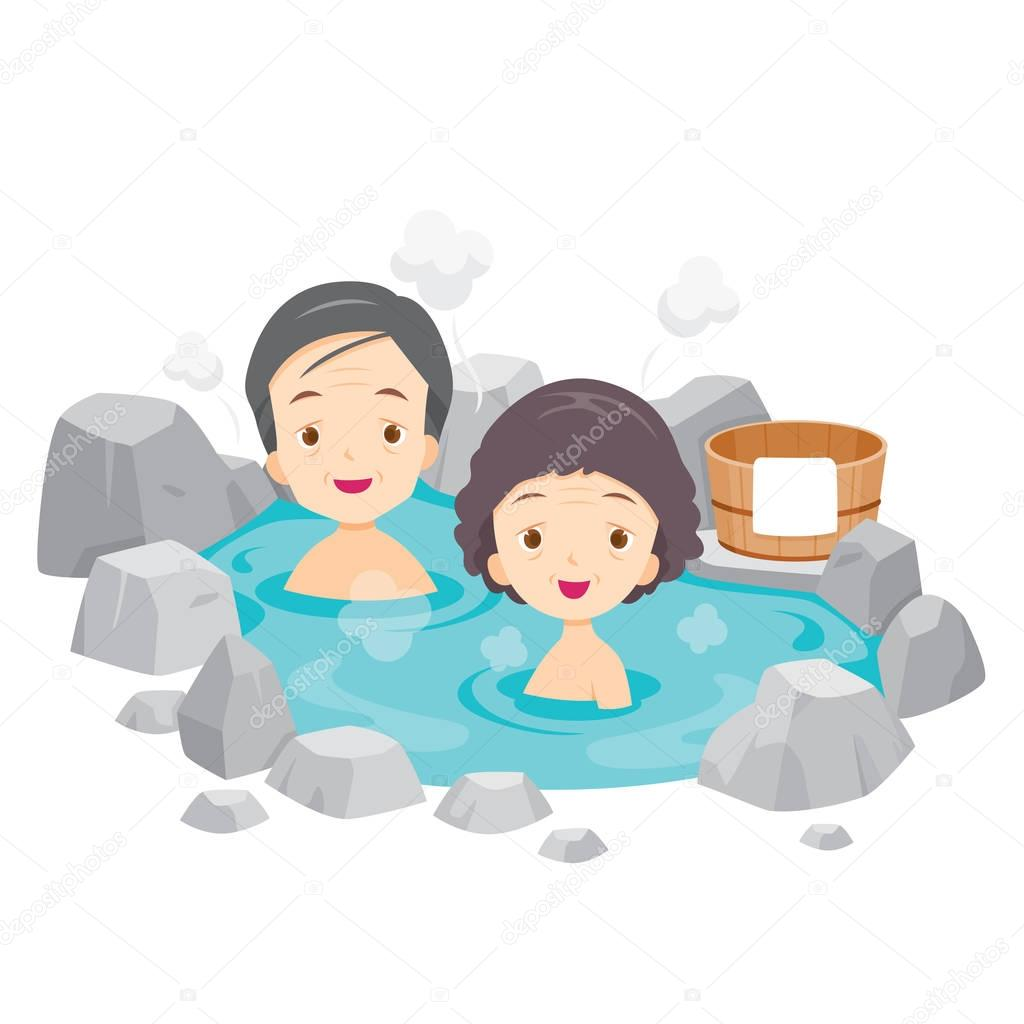 Old Man And Woman Relaxing In Hot Spring