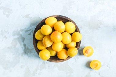 Fresh yellow cherry plum in a bowl