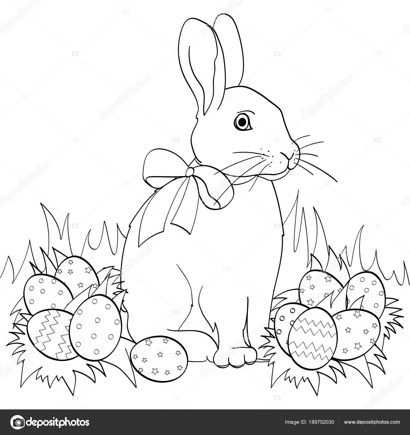 Conejito de Pascua sobre la hierba verde, huevos de Pascua. Libro ...