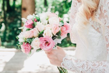 Wedding image and a bridal bouquet with red flowers