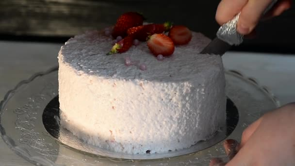 The pastry chef cut the cake. Strawberry yogurt cake. Consists of butter sponge cakes,covered with cream-based live strawberry yoghurt. Filling : fresh strawberries and strawberry confit. Insanely