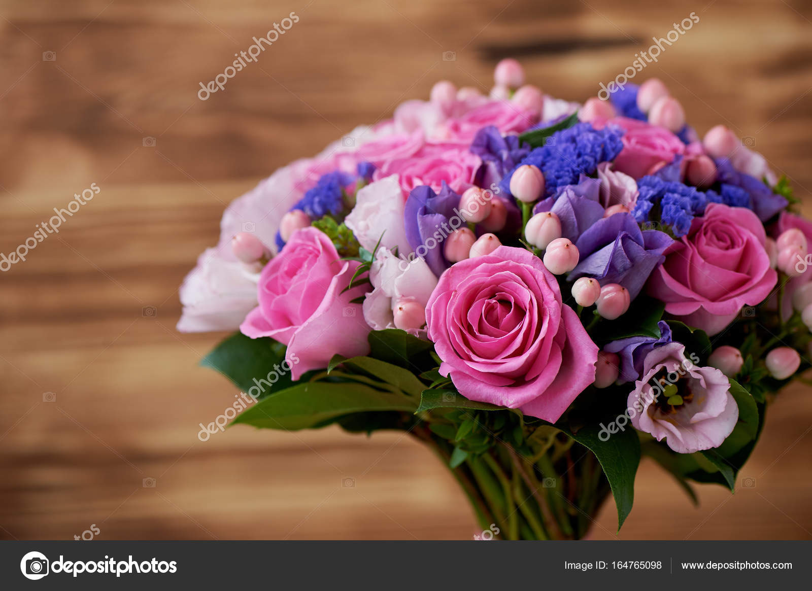 Wooden background, Wedding bouquet in pink and purple tones ...