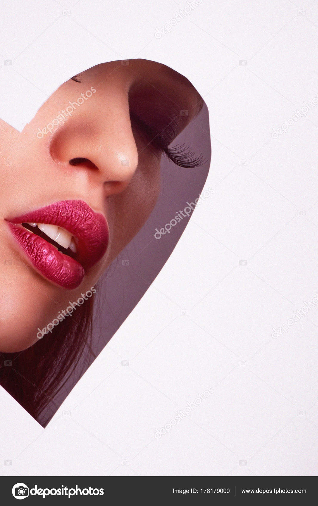 082677c14e8 A large image of a beautiful girl with false eyelashes and plump lips.