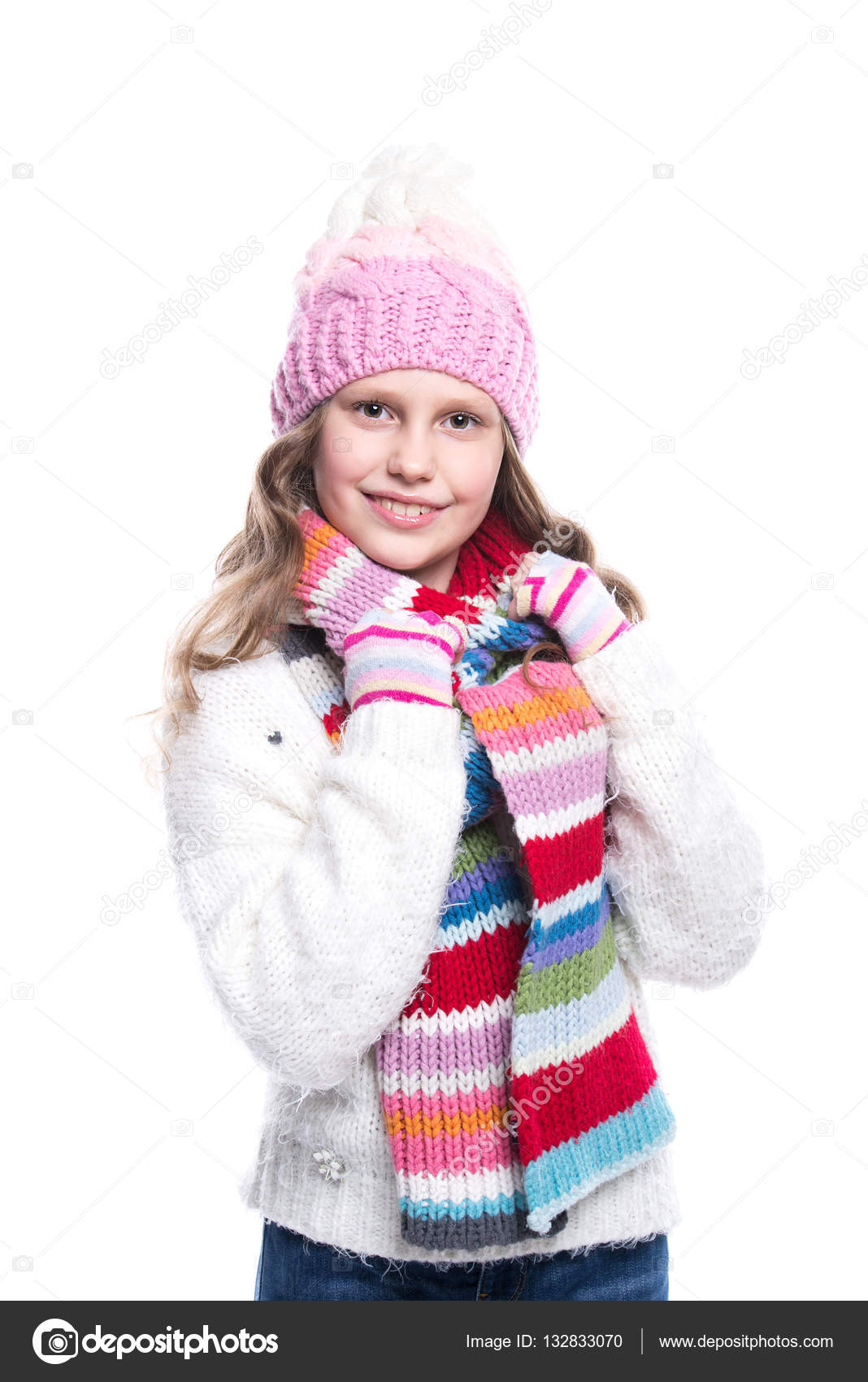 e04b05265 Smiling cute little girl wearing knitted sweater and colorful scarf ...