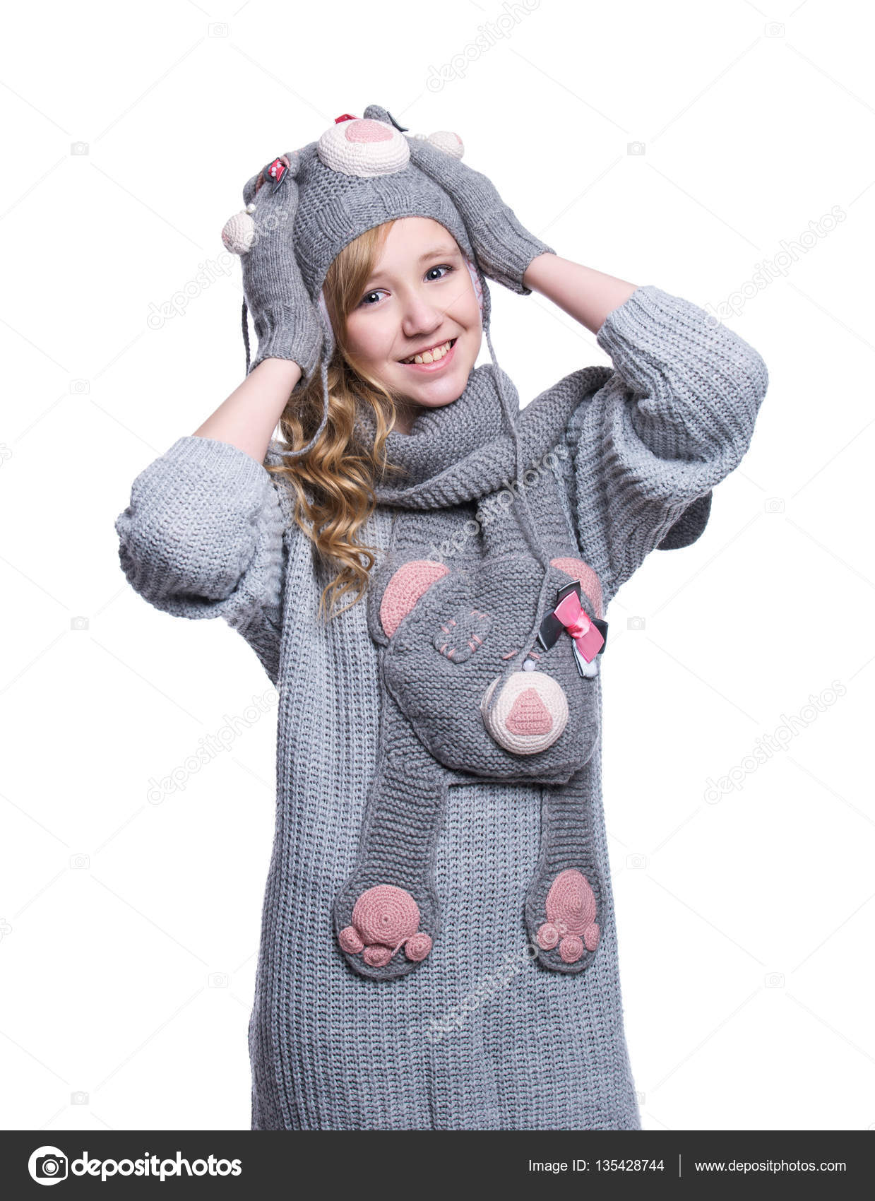 Lovely cheerful teenage girl wearing fuzzy sweater, scarf, mittens