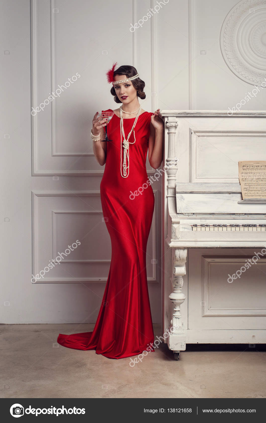 Young Beautiful Girl In Red Dress Style Of The 20 S Or 30 S With
