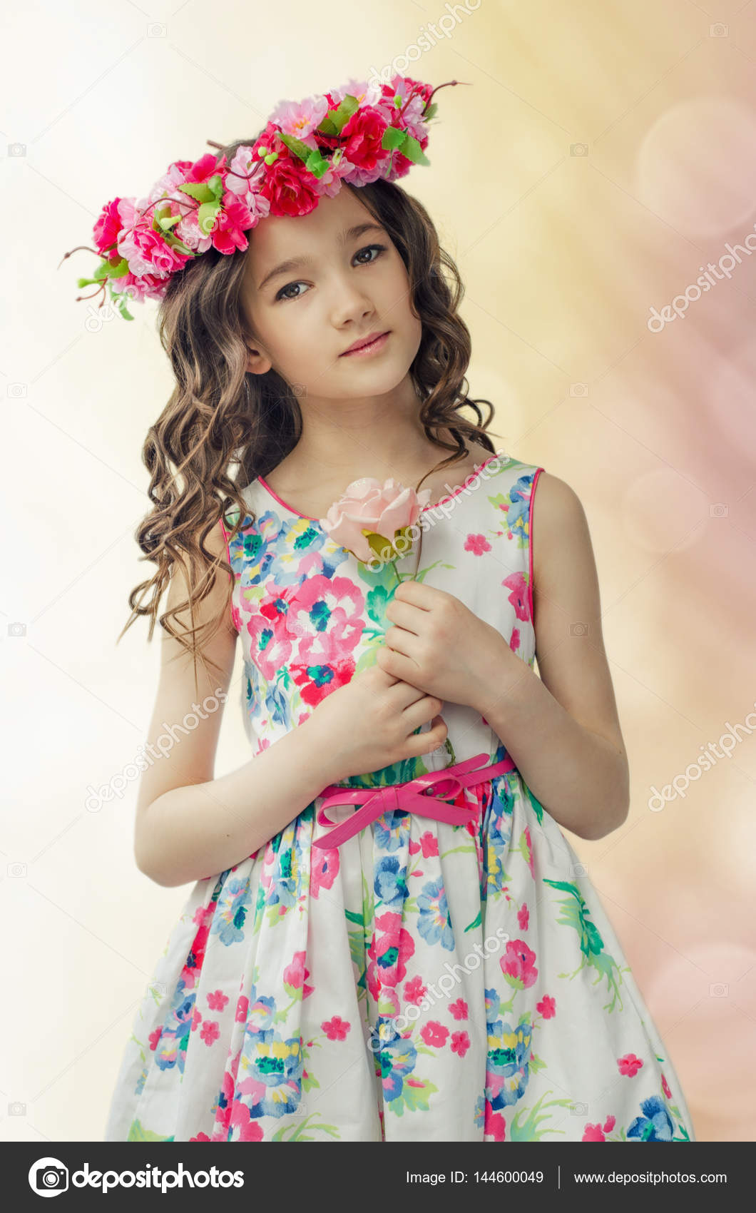 portrait of cute little girl in nice spring dress, with flower