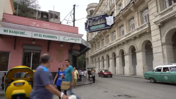Famous cuban mojito bar placed on central street of Havana. People are walking by