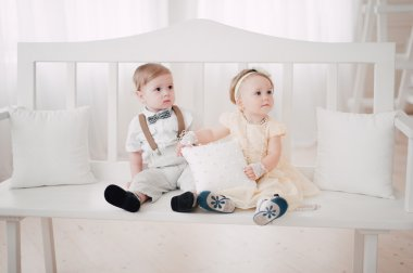 two babies wedding - boy and girl dressed as bride and groom