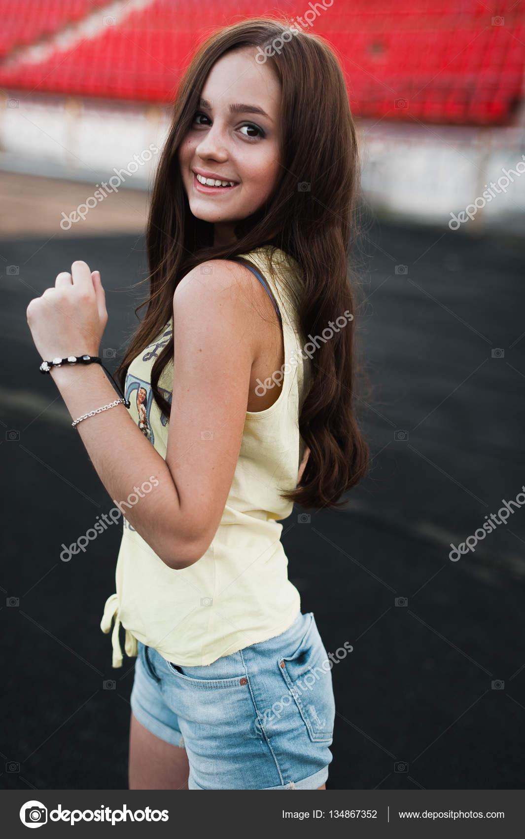 Girl Having Fun Outdoor Pretty Girl Sitting At School Stadium