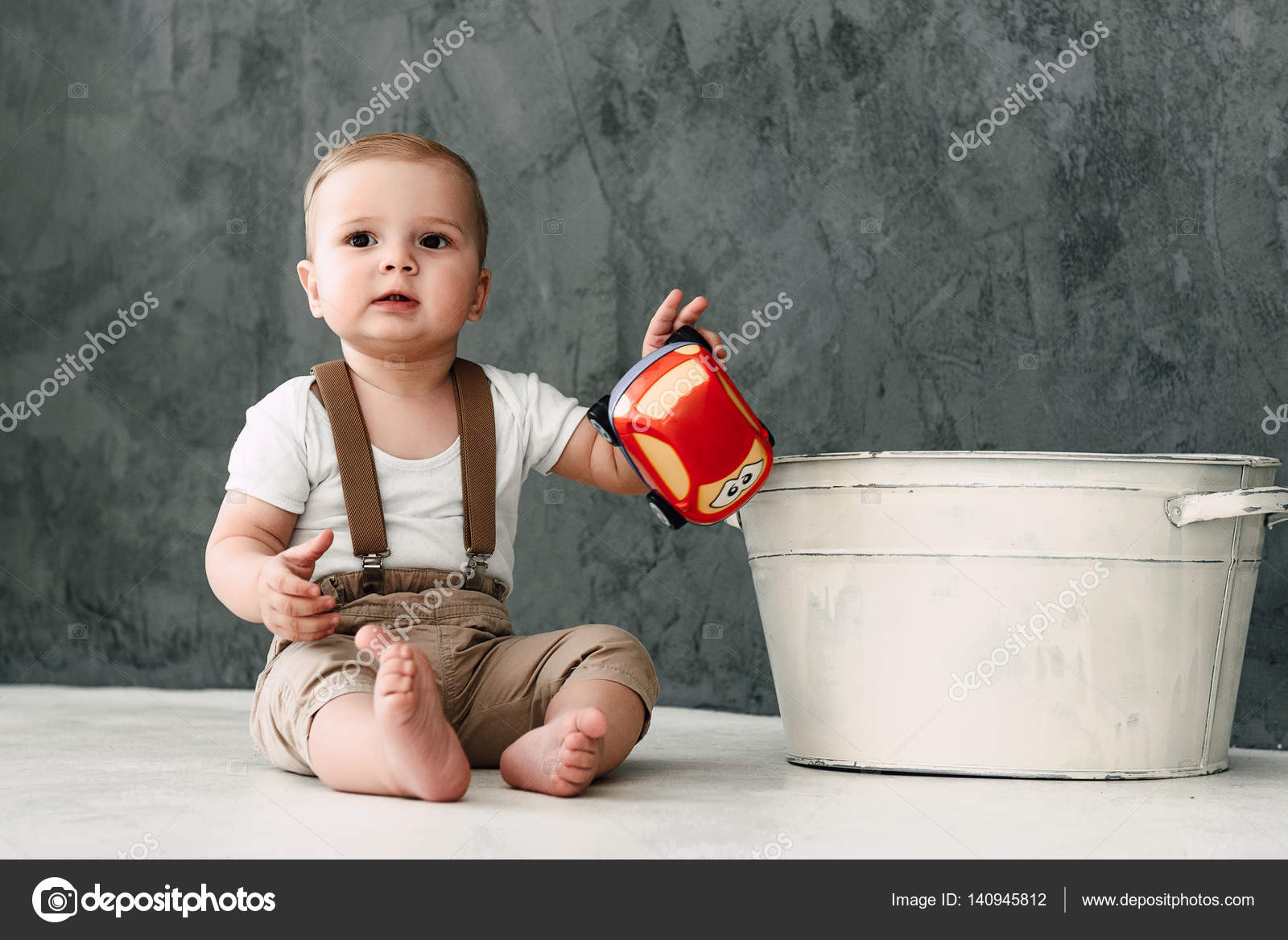 Portrait Of Lovely Little Boy Happy Smiling Celebrating 1 Year Birthday One Old European Sitting On Floor In Studio Photo By