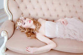picture of young blonde woman wearing wreath of flowers, spring tender and romantic portrait, fashion retouched shot
