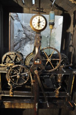 The mechanism of the old clock mounted on the town hall.
