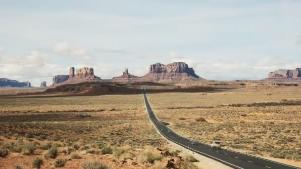 time lapse shot of cars traveling along highway 163 at monument valley in utah