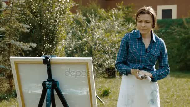Portrét ženy malíř obraz letní krajina s olejovými barvami. 4k