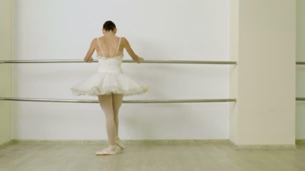 Classical ballet. Ballerina dancing in pointe shoes in dance studio. 4K