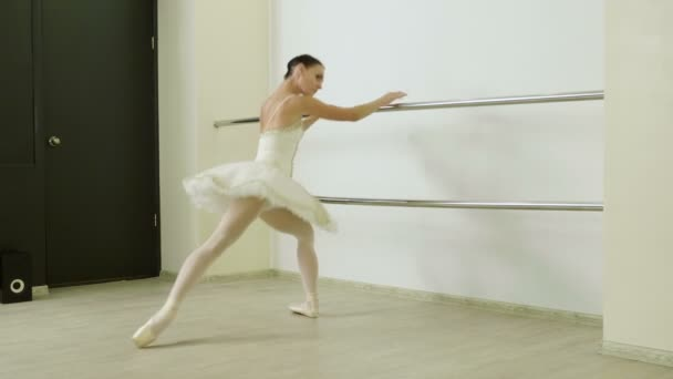 Classical ballet. Ballerina dancing in pointe shoes in dance studio. 4K